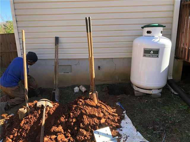 Cracked Foundation Supported with Push Piers in Forsyth, GA - Before Photo