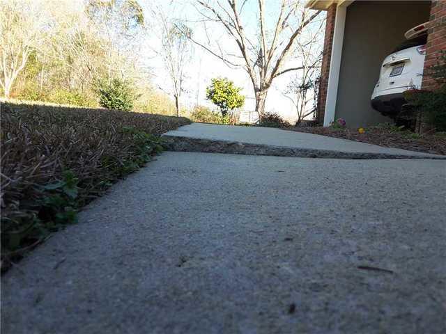 Sinking Sidewalk and Driveway Fixed in Statesboro, GA
