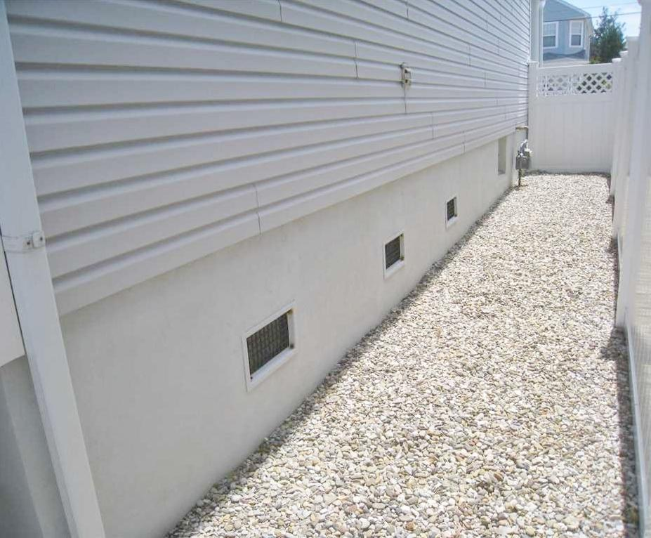 Crawlspace Vent Covers Installed in Lavallette, NJ - Before Photo