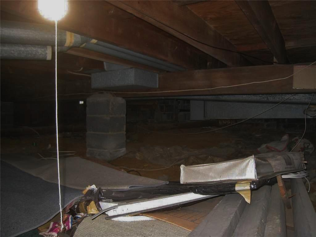 Moisture Barrier Installed in Crawl Space in East Brunswick, NJ - Before Photo
