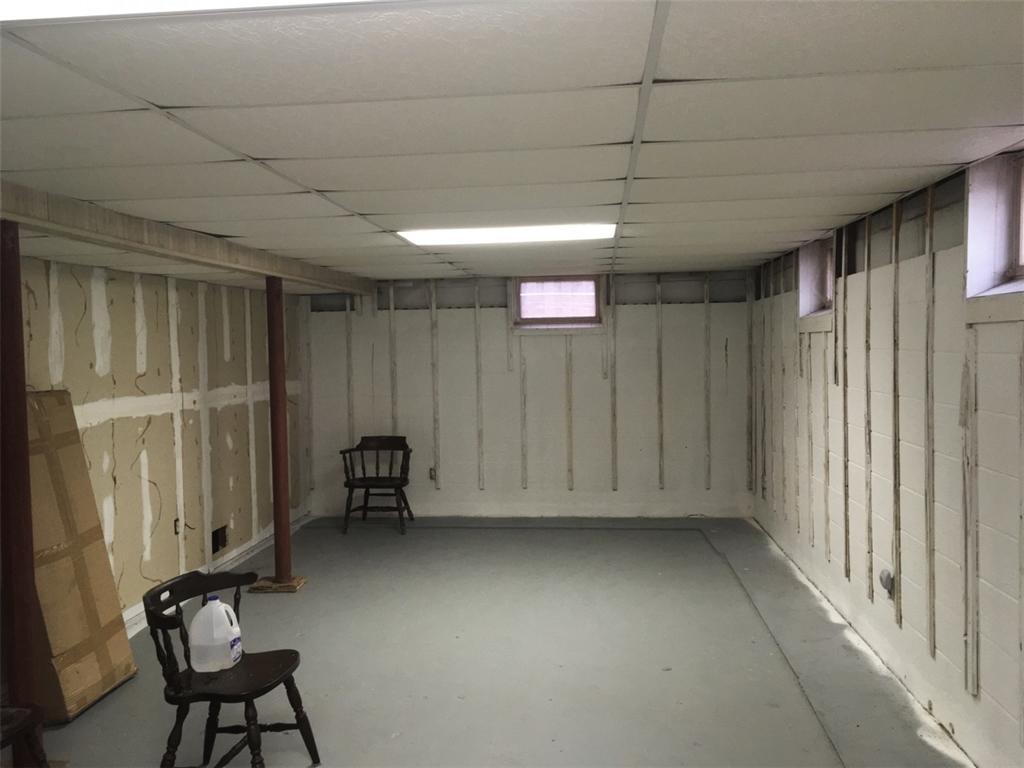 Basement Finishing Transformation in Hillsborough, NJ - Before Photo