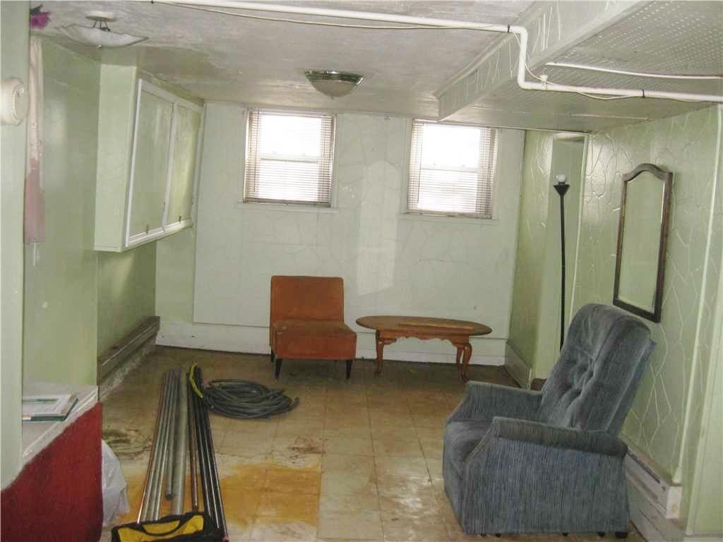 Finishing a Basement with New Walls and Flooring in New Brunswick, NJ - Before Photo