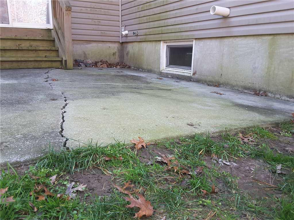Cracked Patio Repaired with NexusPro in Absecon, NJ - Before Photo