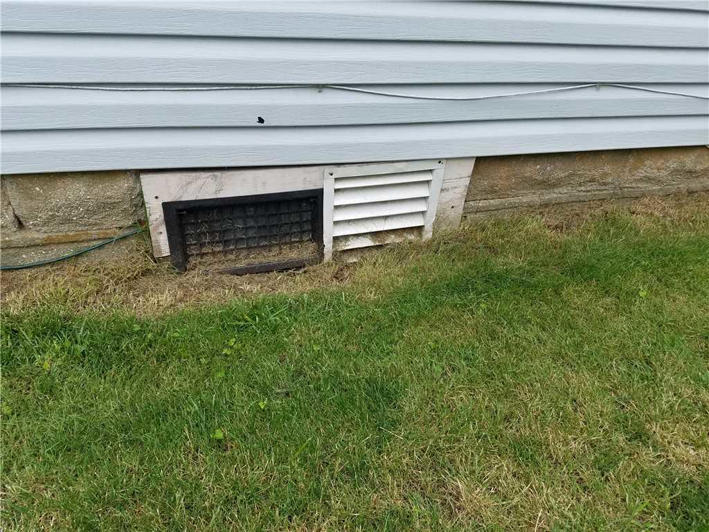 Vent Covering to Crawlspace in New Egypt, NJ - Before Photo