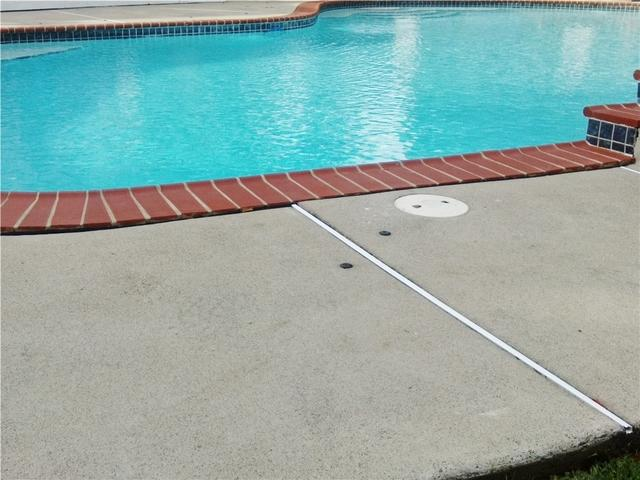 Sinking Step Around South Plainfield Pool Area is Repaired