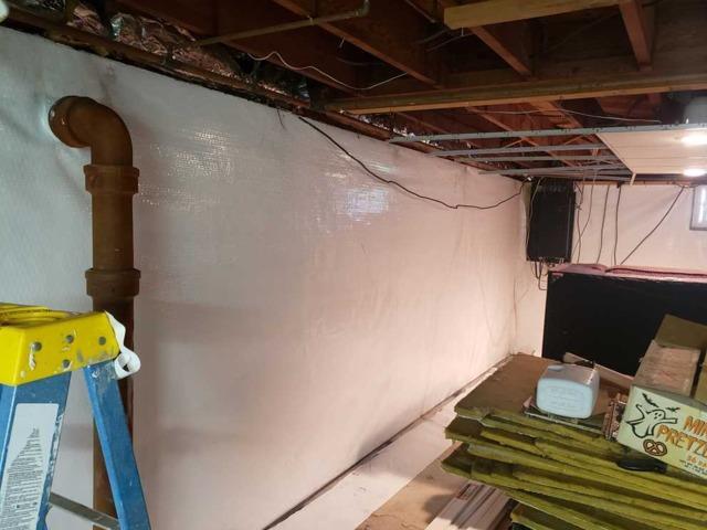 Moisture Vapor Barrier Installed to Seal the Basement