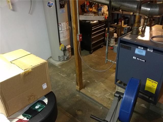 Waterproof Basement Flooring Installed in Brielle, NJ - Before Photo