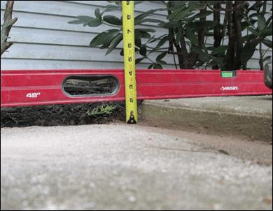 Lifting Concrete to Avoid Trip Hazard - Before Photo