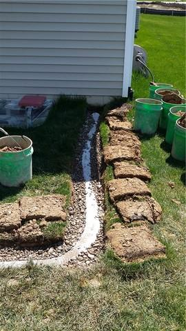 Downspout Extension Leads Water Away from Okemos, MI Home