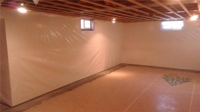 Basement Wall Leaks Fixed with WaterGuard and CleanSpace in Lansing, MI