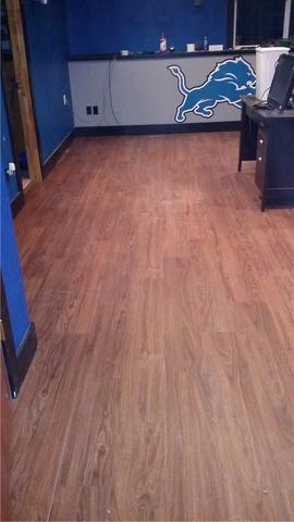 Laminate Flooring Replaces Ruined Carpet In Zeeland, MI