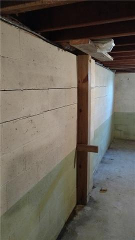 Bowing Wall Secured With Wall Anchors In St Johns, MI