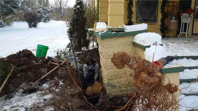 Sinking Corner of Front Porch Lifted in Olivet, MI