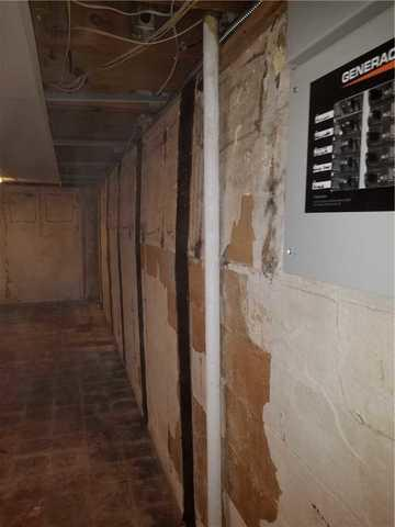 Cracked Basement Wall in Lansing, MI Repaired