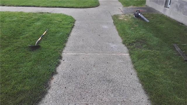 Muskegon, MI Home with Cracked Concrete Pathway