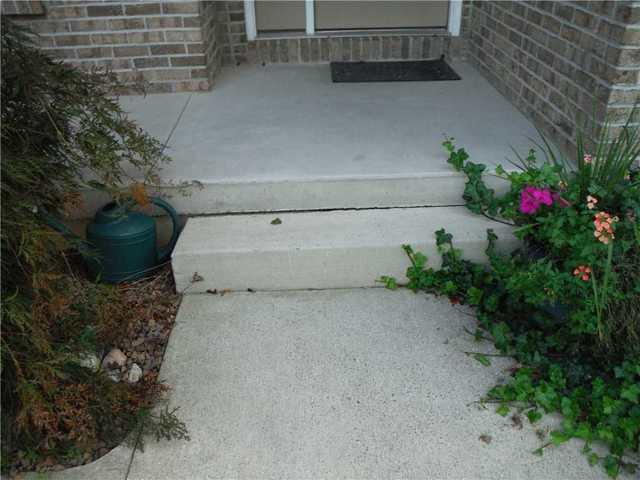 Caledonia,MI Home with Unlevel Concrete Walkway