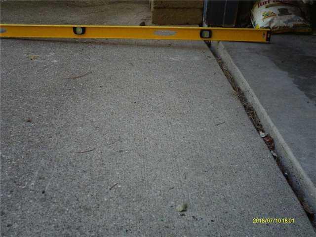 PolyLevel Bridges the Gap Between a Driveway & Garage in Lansing, MI