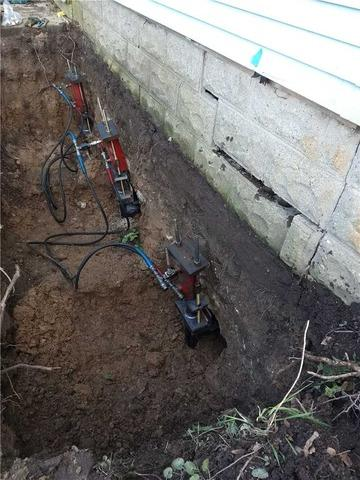 Saving a Settling Home with Helical Piers