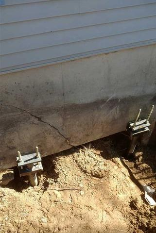 Installing Helical Piers to Save a Settling Home
