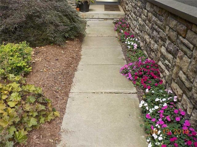 Using PolyLevel to Save a Walkway in Dimondale MI