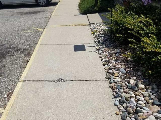 Fixing Sidewalks with PolyLevel in Kalamazoo, MI