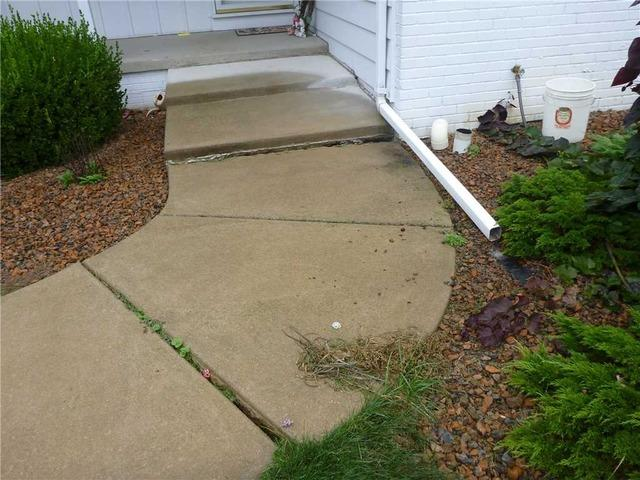 Using PolyLevel to Even out a Walkway in Delhi Charter Township, MI