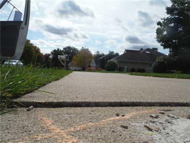 PolyLEVEL Solves Concrete Settling in Charlevoix, MI