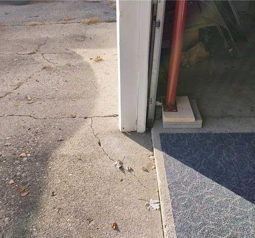 Stabilizing and Lifting a Sunken Garage