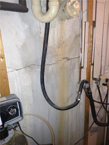 Geo-Lock Anchors and PowerBrace Save a Bowing Wall in Charlotte, MI