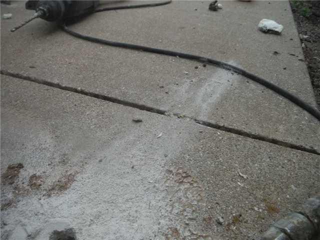 PolyLEVEL Raises Sinking Sidewalk in Newaygo, MI