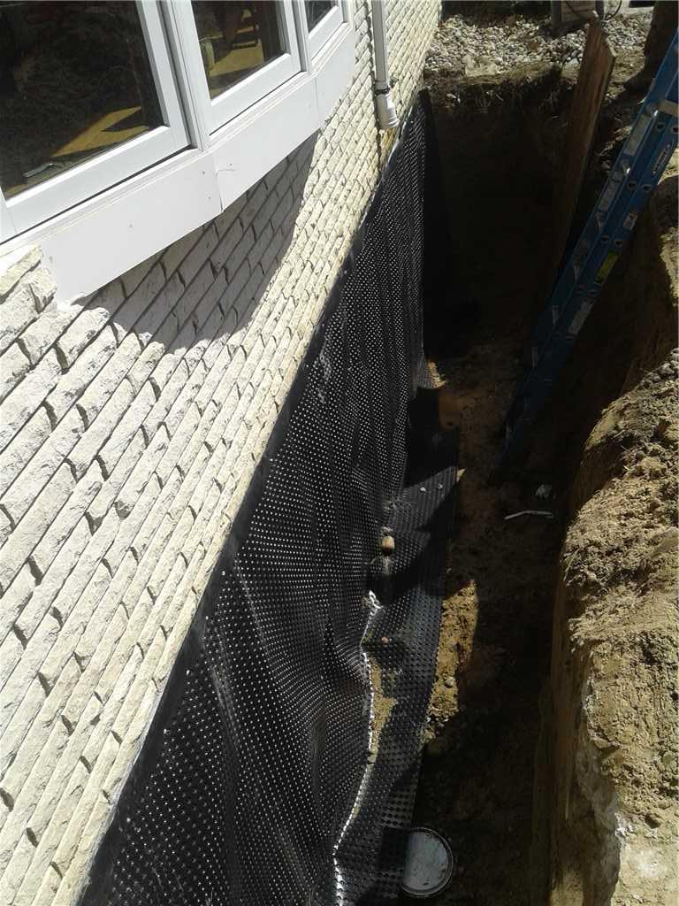 Waterproofing From the Outside in Elkhart Lake, WI - Before Photo