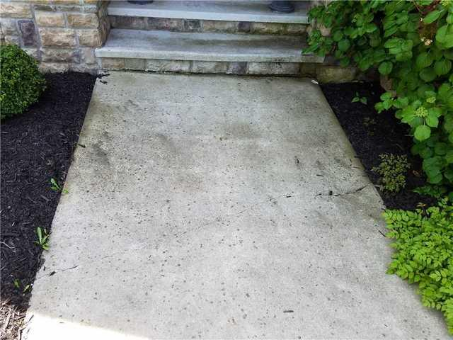 Lifting Sidewalk Back to Stair Level in De Pere, WI