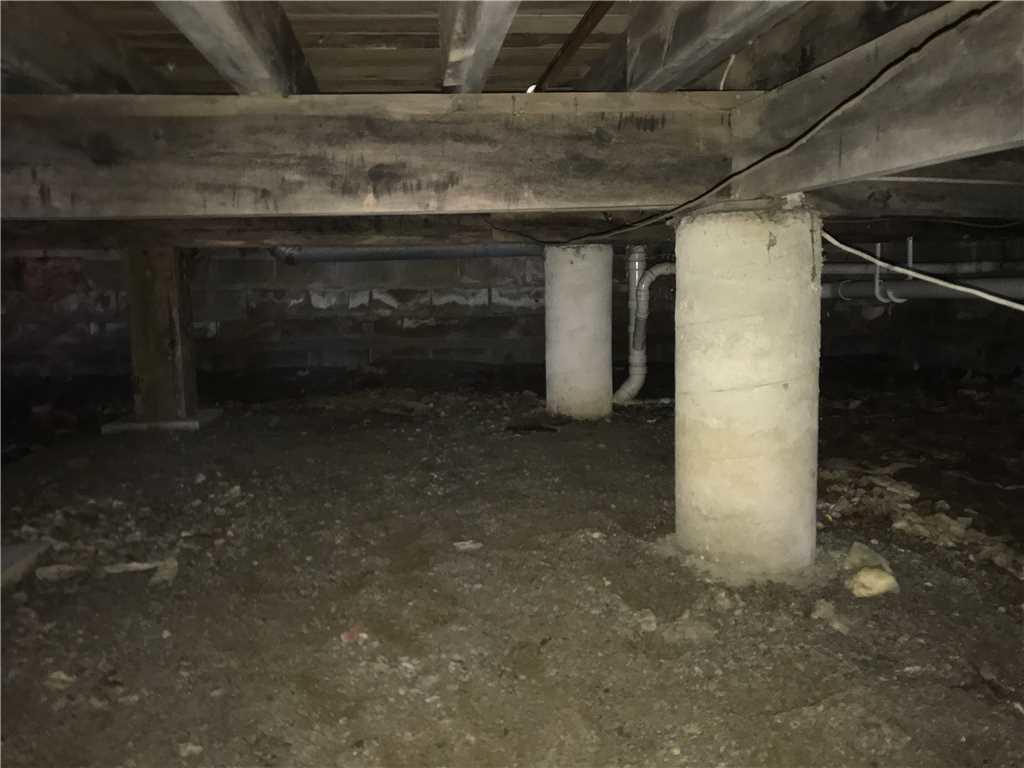 Damp Crawl Space in Saco, Maine - Before Photo