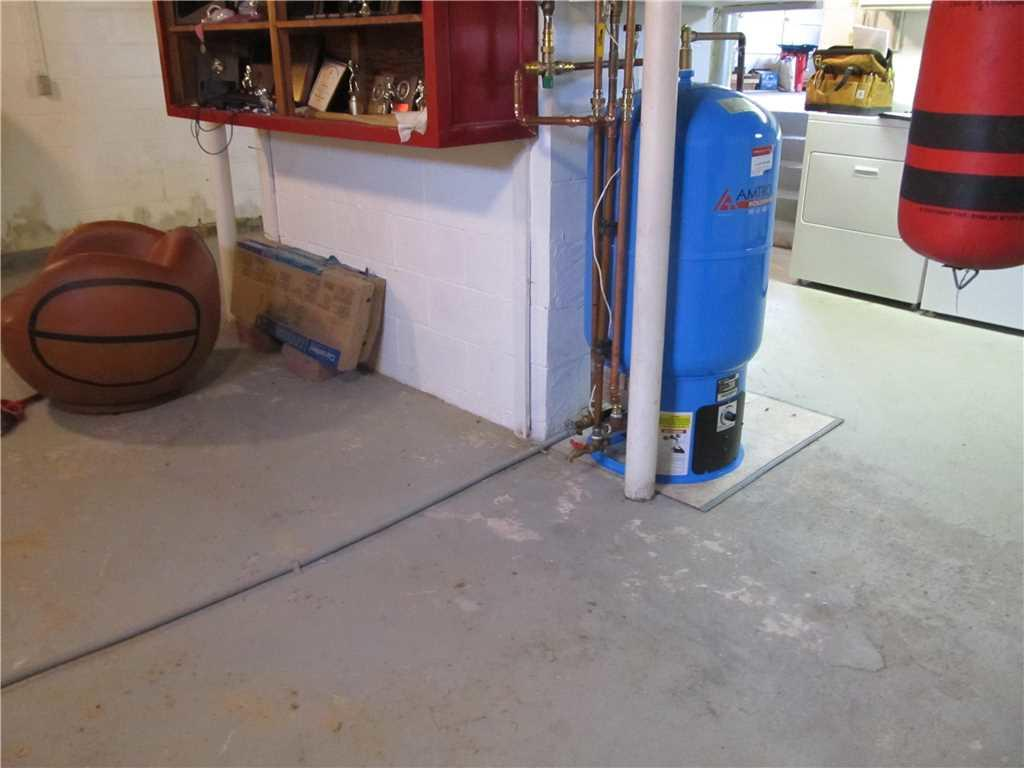 WaterGuard Installation Protects Augusta, ME Basement From Leakages - Before Photo