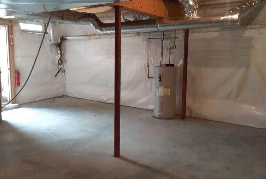 Fresh Basement Slab with WaterGuard Piping Saves South Berwick, ME Basement from Moisture - After Photo