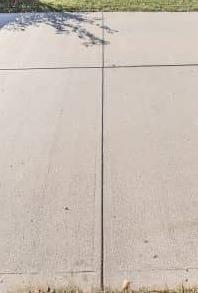 Concrete Expansion Joint Prevents Driveway Cracking and Structural Damage - Before Photo