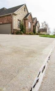 Concrete Driveway Joint Sealant Adds Protection Against Future Damage - Before Photo