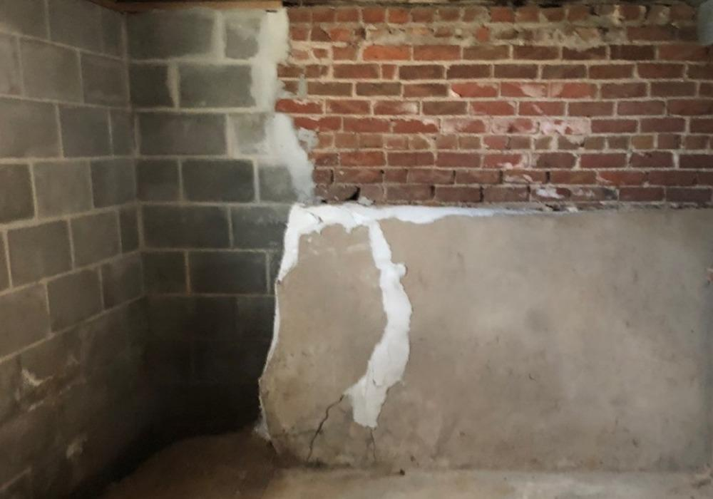 Waterproofing an Older Home with a Brick Foundation in Omaha - Before Photo