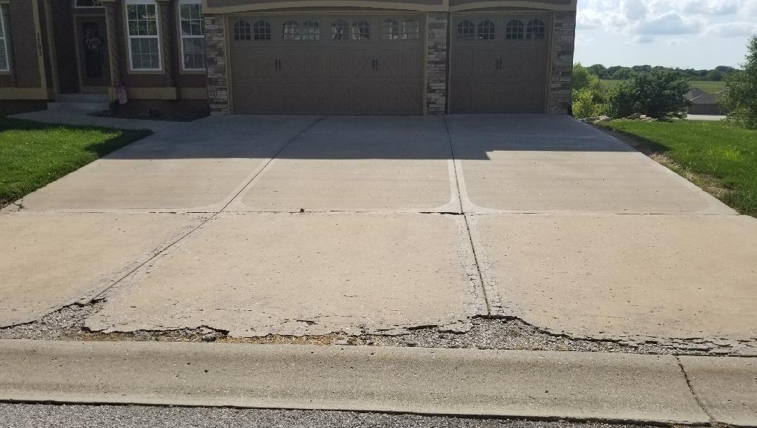 Crumbling Driveway in Raymore, MO Repaired - Before Photo
