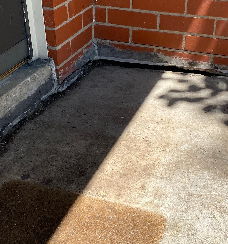 Concrete Settlement Repair in Overland Park, KS - Before Photo