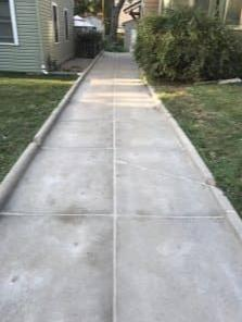 Long Narrow Driveway Repaired with PolyLevel - After Photo