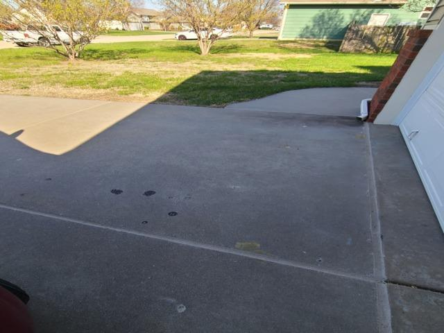 Settling Concrete in Park City, KS fixed using PolyLevel and NexusPro Joint Sealant