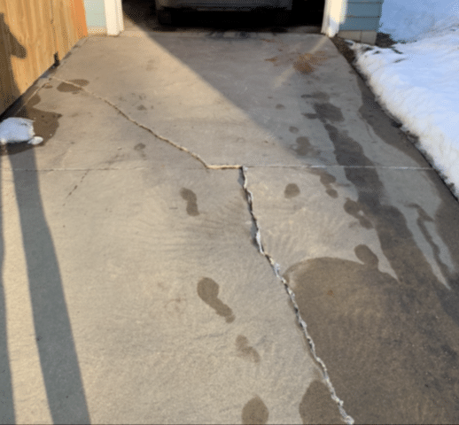 Two Part Concrete System Levels Driveway in Sioux City, IA
