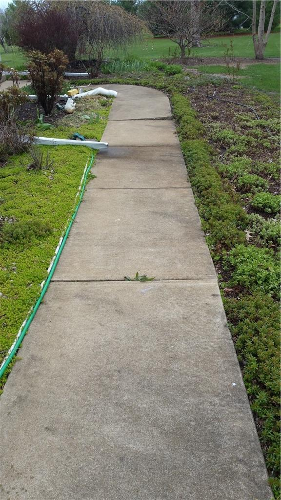 PolyLEVEL Restores Champaign, Illinois Walkway - Before Photo