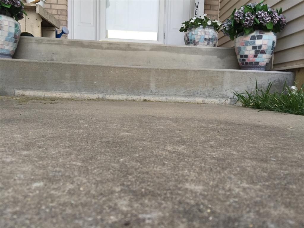 PolyLevel Makes Walkway and Driveway even in Spaulding, IL - Before Photo