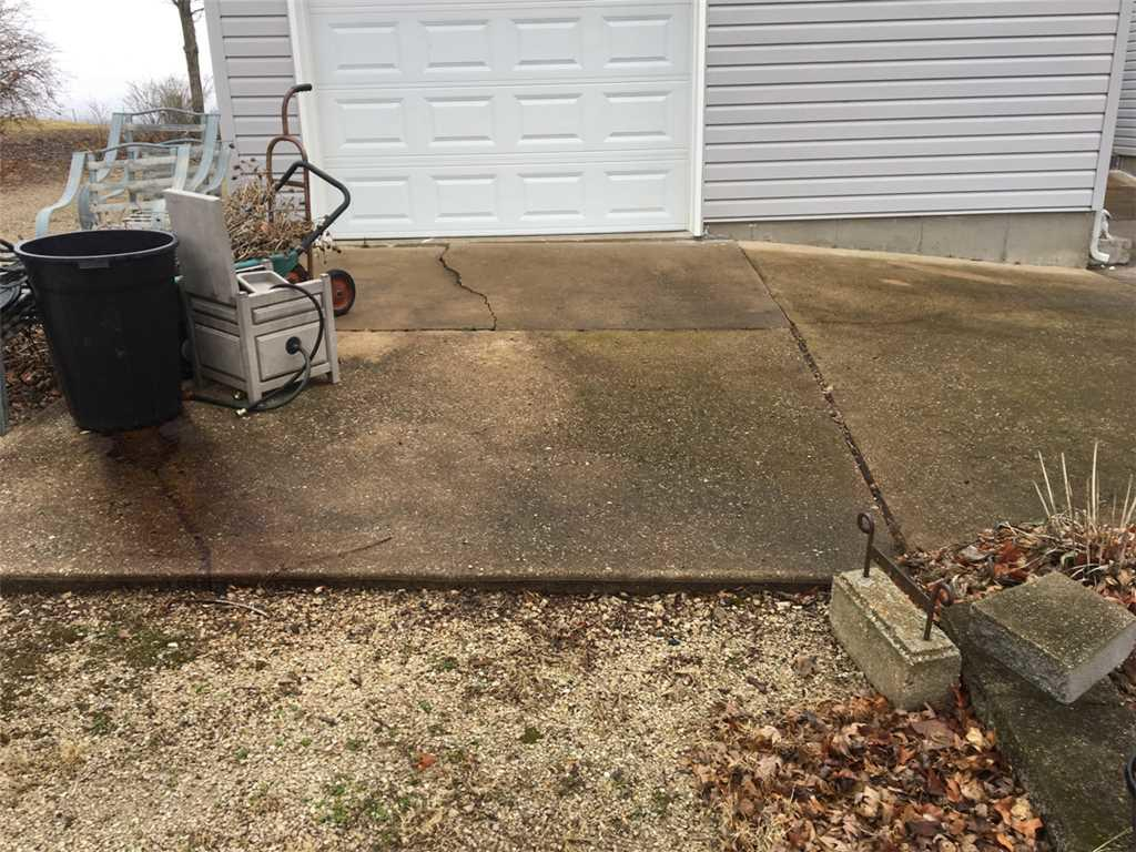 Sunken, Cracked Driveway Fixed With PolyLevel In Labadie, MO - Before Photo