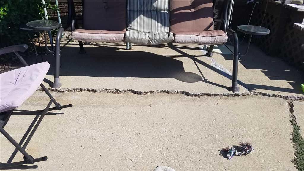 Badly Damaged Centralia, IL Patio Repaired With PolyLevel - Before Photo
