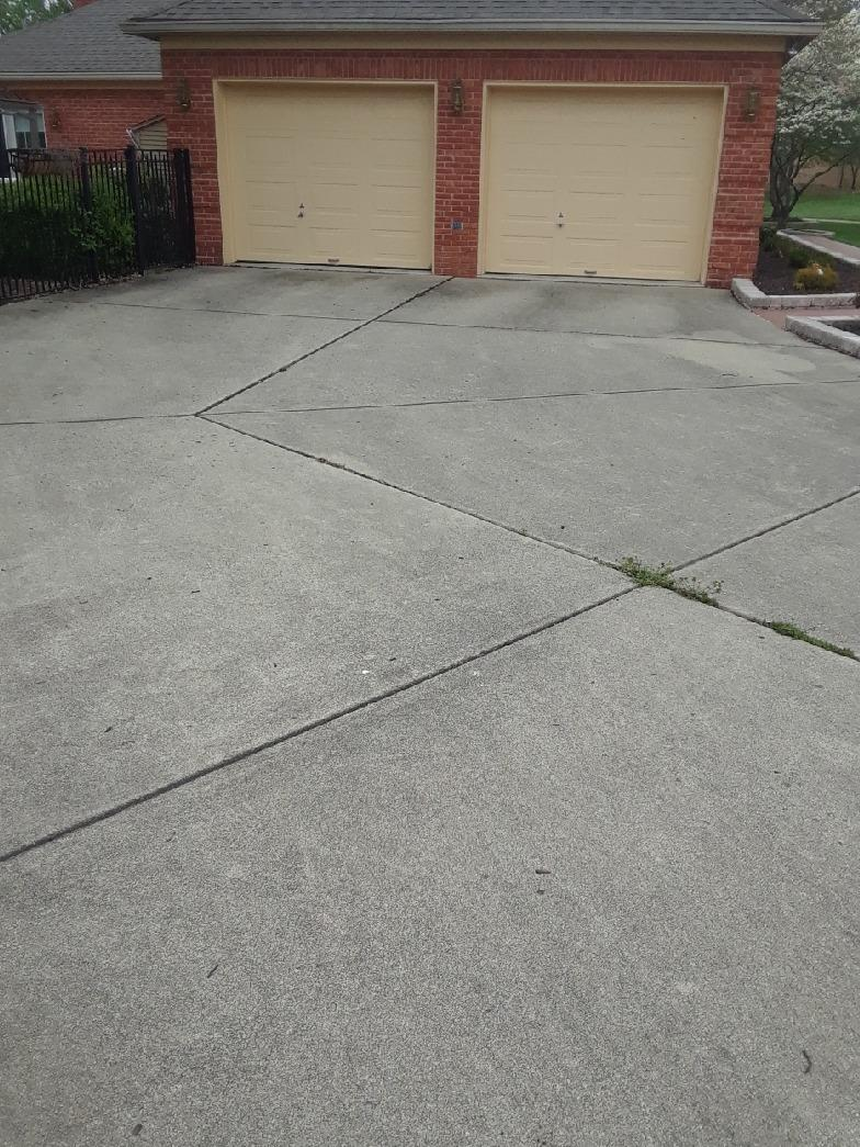 Lifting Concrete Driveway in Henley, MO - Before Photo
