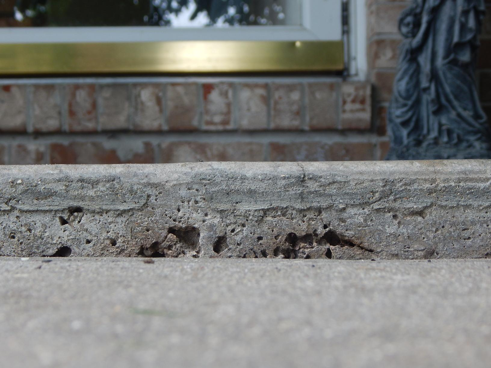 PolyLEVEL Injected into a Sidewalk in Highland, IL - Before Photo