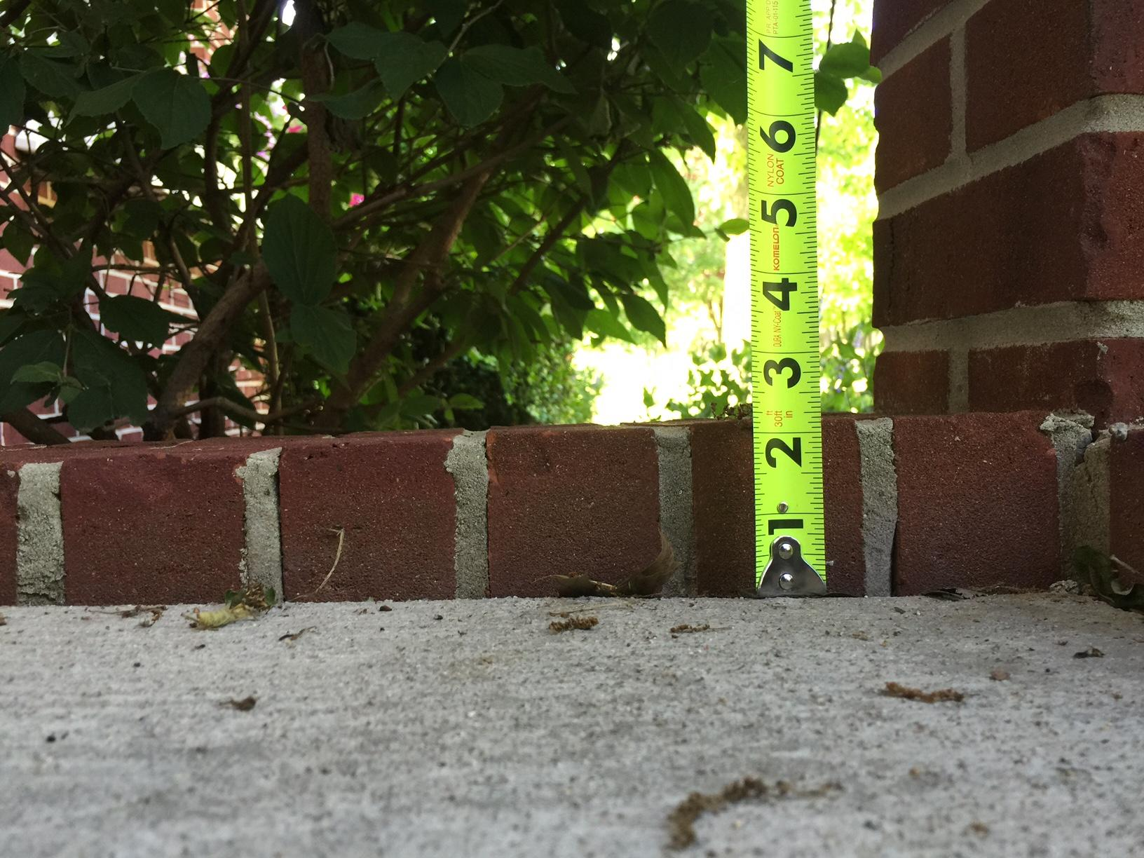 Mascoutah, IL Settling Porch Slab Repaired - Before Photo
